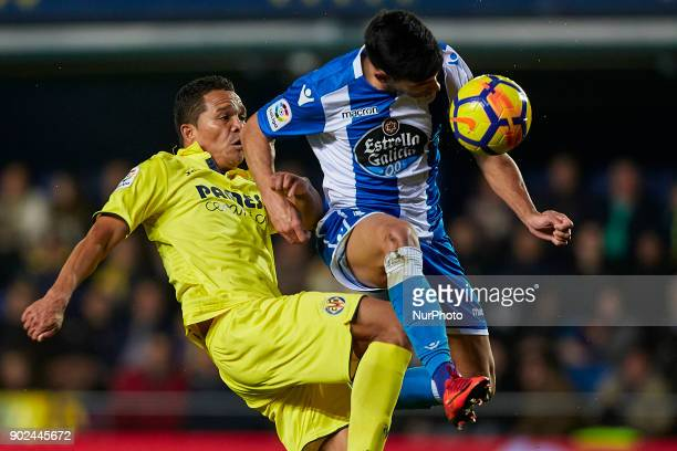 Juanfran of Deportivo de La Coruna heads the ball next to Bacca of Villarreal CF during the La Liga game between Villarreal CF and Deportivo La...