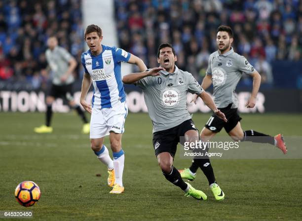 Juanfran of Deportivo La Coruna in action against Alexander Szymanowski of Leganes during the La Liga football match between Leganes and Deportivo La...