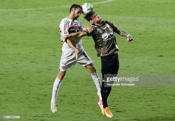 Juanfran of Sao Paulo and Luiz Henrique of Coritiba fight for the ball during the match as part of of Brasileriao Series A at Morumbi Stadium on...