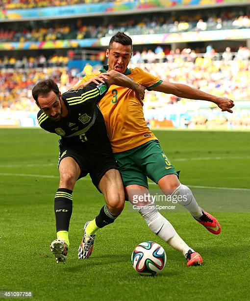 Juanfran of Spain competes for the ball with Jason Davidson of Australia during the 2014 FIFA World Cup Brazil Group B match between Australia and...