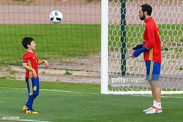 Juanfran of Spain plays with his son Oliver Torres after a training session at Complexe Sportif Marcel Gaillard on June 19, 2016 in La Rochelle,...