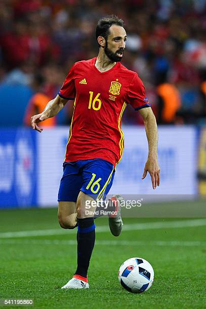 Juanfran of Spain runs with the ball during the UEFA EURO 2016 Group D match between Spain and Turkey at Allianz Riviera Stadium on June 17 2016 in...