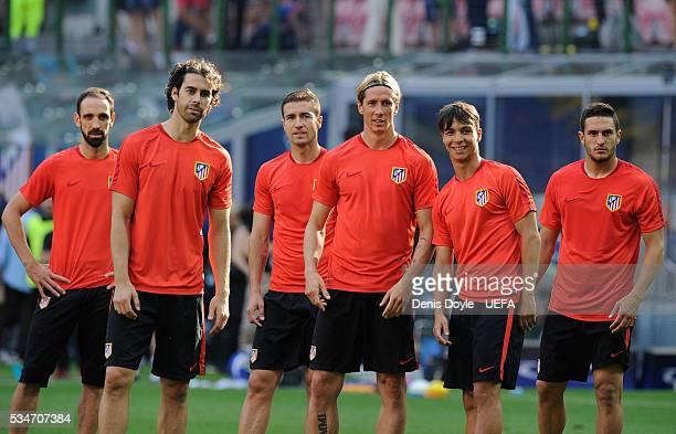 Juanfran Tiago Mendes Gabi Fernandez Fernando Torres Oliver Torres and Koke Resurreccion look on during an Atletico de Madrid training session on the...