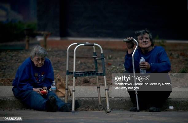 Juanita and Wayne McLish sit on a curb after losing their home in the Camp Fire raging through Paradise Calif Thursday November 8 2018