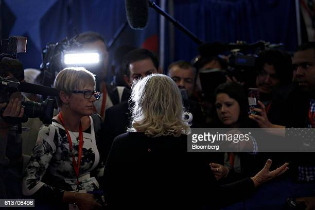 Juanita Broaddrick speaks to members of the media in the spin room after the second US presidential debate at Washington University in St Louis...