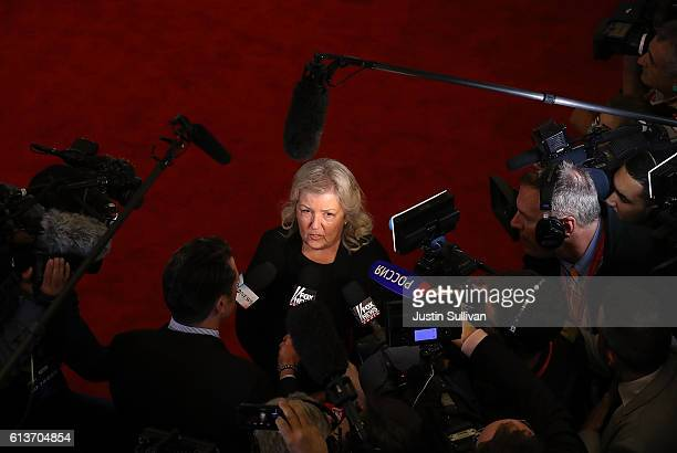 Juanita Broaddrick speaks to reporters in the spin room following the second presidential debate with democratic presidential nominee former...