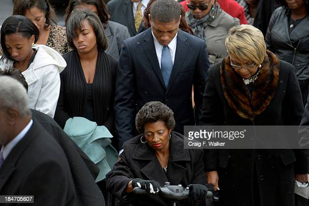 Juanita Rogers seated prays with her children Haley Jordan and Trent during a service for her husband former Lt Gov Joe Rogers at the state Capitol...