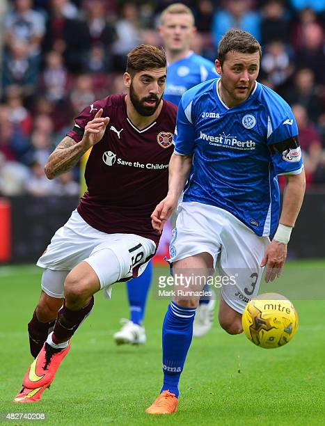Juanma Delgado of Hearts challenges Thomas Scobbie of St Johnstone during the Ladbrokes Scottish Premiership match between Heart of Midlothian FC and...