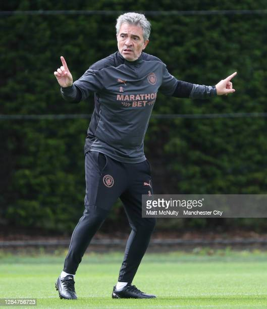 Juanma Lillo Assistant Manager of Manchester City gives instructions during a training session at Manchester City Football Academy on July 03 2020 in...