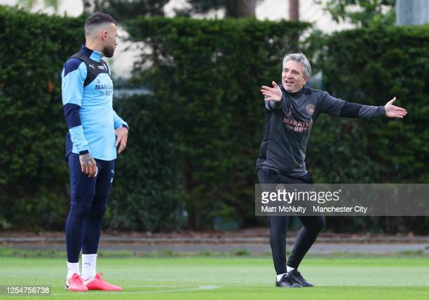 Juanma Lillo Assistant Manager of Manchester City gives instructions to Nicolas Otamendi during a training session at Manchester City Football...
