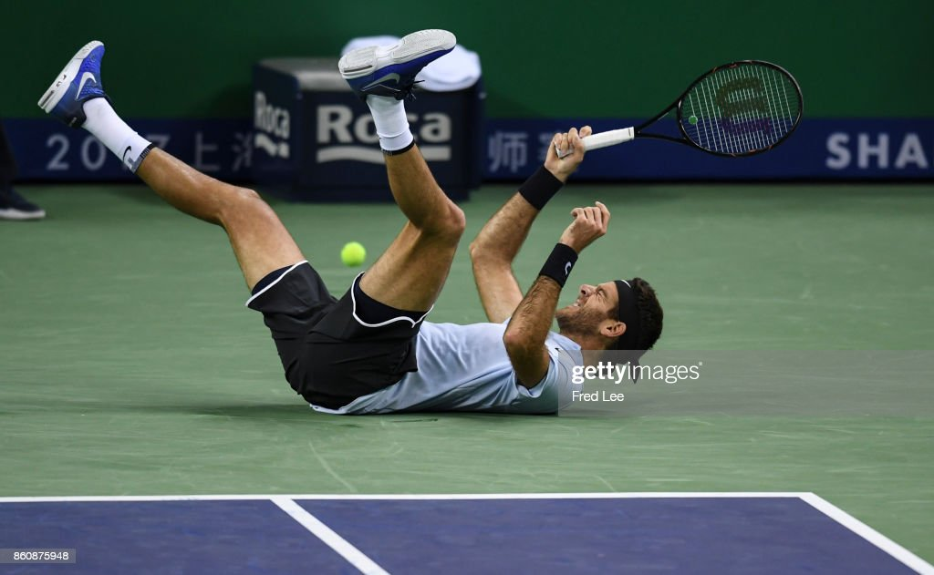 Juan-Martin Del Potro of Argentina slips fall during agains the Men's singles quarter final mach Viktor Troicki of Serbia on day six of 2017 ATP Shanghai Rolex Masters at Qizhong Stadium on October 13, 2017 in Shanghai, China.