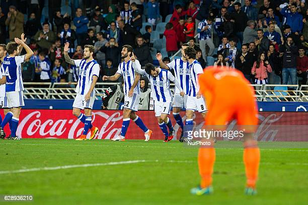 Juanmi of Real Sociedad celebrates with teammates after scoring during the Spanish league football match between Real Sociedad and Valencia at the...