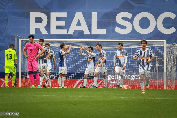 Juanmi of Real Sociedad celebrates with teammates after scoring during the Spanish league football match between Real Sociedad and Levante at the...