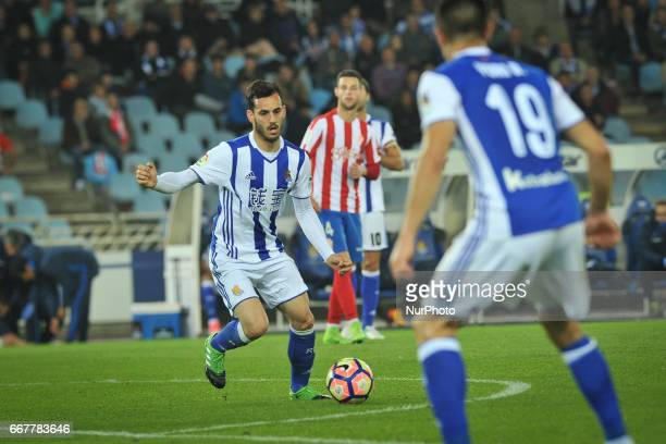 Juanmi of Real Sociedad controlls the ball during the Spanish league football match between Real Sociedad and Sporting Gijon at the Anoeta Stadium in...