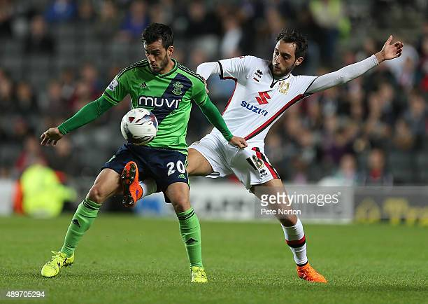 Juanmi of Southampton attempts to control the ball under pressure from Sergio Aguza of MK Dons during the Capital One Cup Third Round match between...