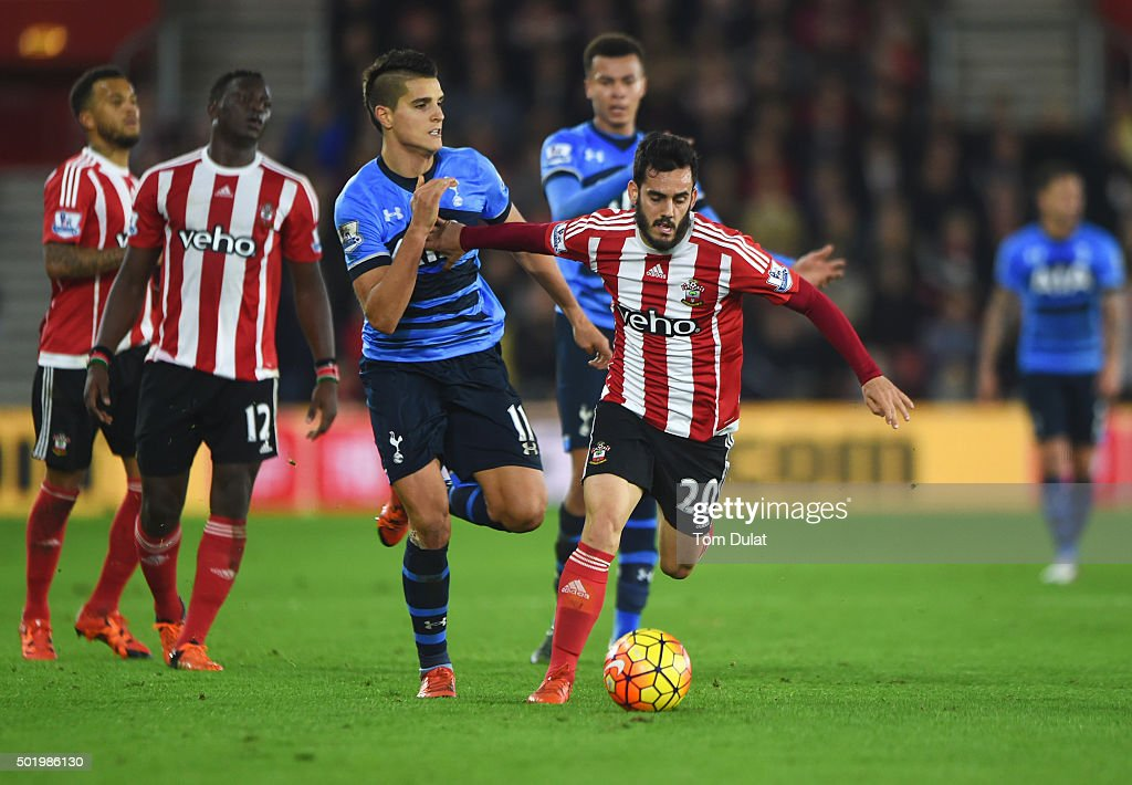 Juanmi of Southampton holds off Erik Lamela of Tottenham Hotspur during the Barclays Premier League match between Southampton and Tottenham Hotspur at St Mary's Stadium on December 19, 2015 in Southampton, England.