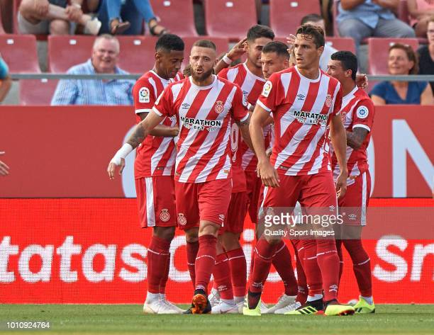 Juanpe of Girona celebrates with teammates after scoring the equalizer during the pre-season friendly match between Girona and Tottenham Hotspur at...
