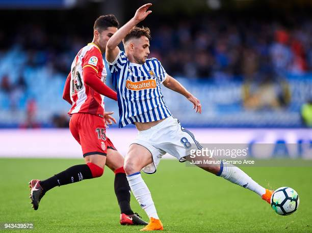 Juanpe Ramirez of Girona FC duels for the ball with Adnan Januzaj of Real Sociedad during the La Liga match between Real Sociedad de Futbol and...