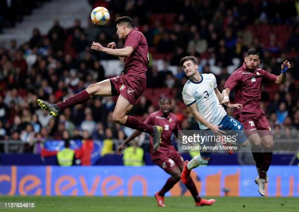 Juanpi of Venezuela heads the ball during the International Friendly match between Argentina and Venezuela at Estadio Wanda Metropolitano on March 22...