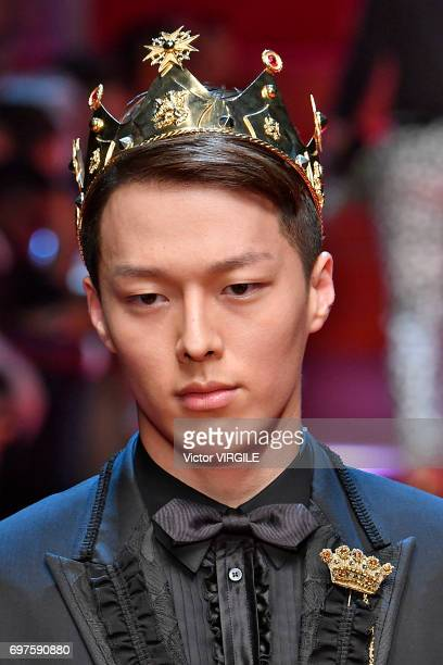 Juanxkui walks the runway at the Dolce Gabbana show during Milan Men's Fashion Week Spring/Summer 2018 on June 17 2017 in Milan Italy