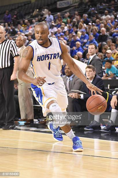 Juan'ya Green of the Hofstra Pride dribbles the ball during the Colonial Athletic Conference Championship college basketball game against the North...