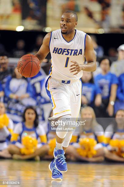 Juan'ya Green of the Hofstra Pride dribbles up court during the Colonial Athletic Conference Championship college basketball game against the North...