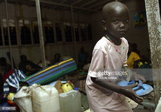 A girl one of some of the 400 southern Sudanese aboard an International Organization for Migration barge on river nile in Juba returns home to the...