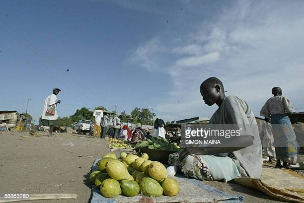 A southern Sudanese woman sells fruits in the town of Juba August 11 August 2005 Food is so scarce in the region in this season despite the fact that...