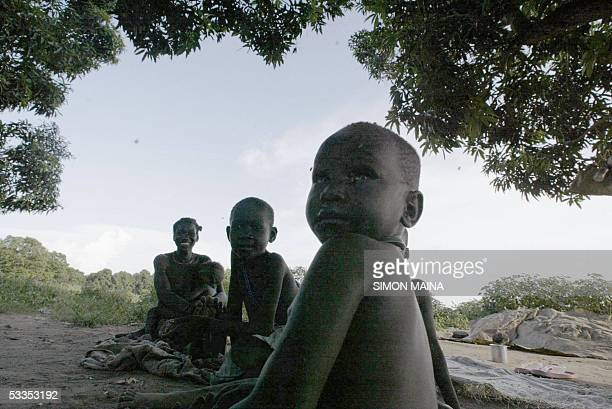 An homeless southern Sudanese woman sits with her children 11 August 2005 in the southern Sudan town of Juba Food aid so scarce in the region in this...