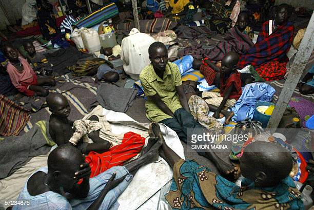Some of the 400 southern Sudanese aboard an International Organization for Migration barge on river nile in Juba return home to the central district...