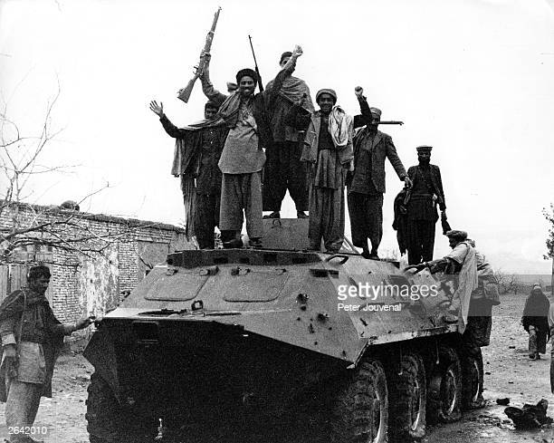 Jubilant Afghan guerrillas on a captured Russian armoured personnel carrier during the war between Afghanistan and the USSR