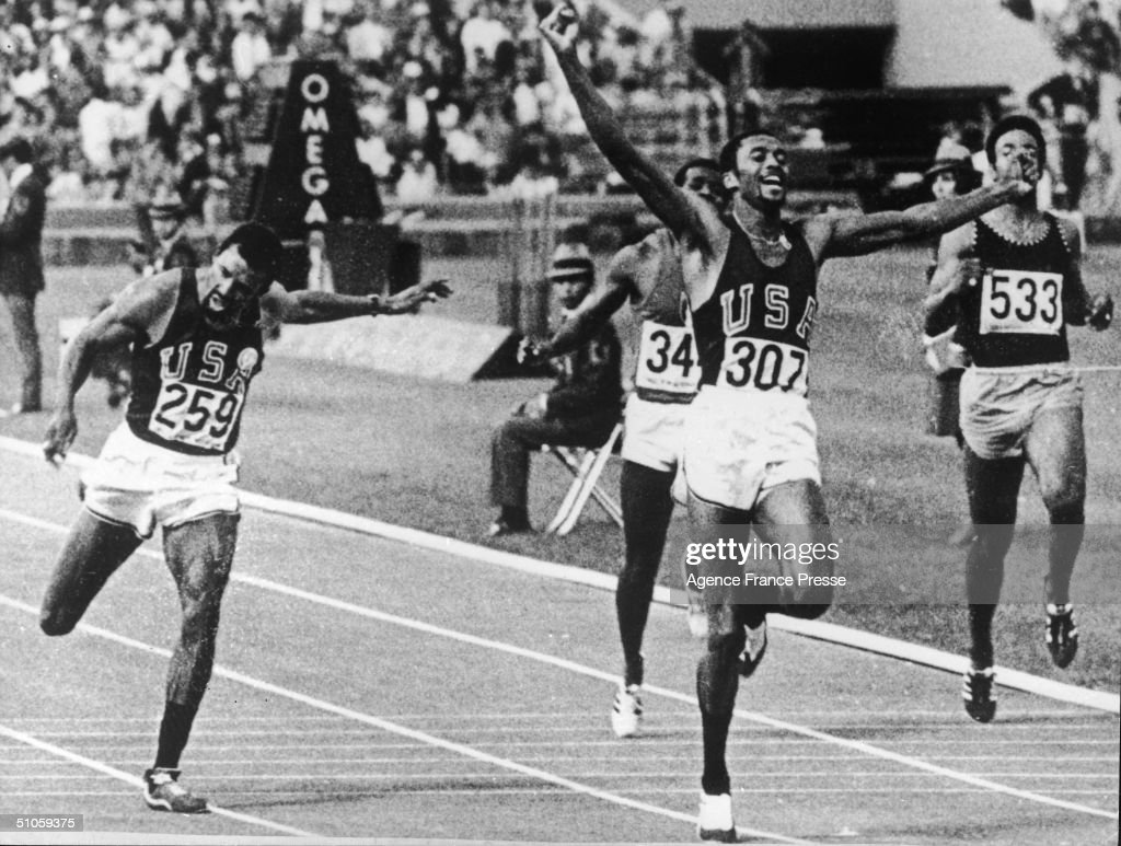 A jubilant American long sprinter Tommie Smith raises his arms as he crosses the finish line to set a new world and Olympic record at the 19th Olympics in Mexico City, October 17, 1968. Smith and his bronze-winning teammate John Carlos (far left, number 259) would cause controversy at their medal ceremony when they raised gloved hands in the 'Black Power' salute (an upraised fist) during the playing of the Star Spangled Banner.