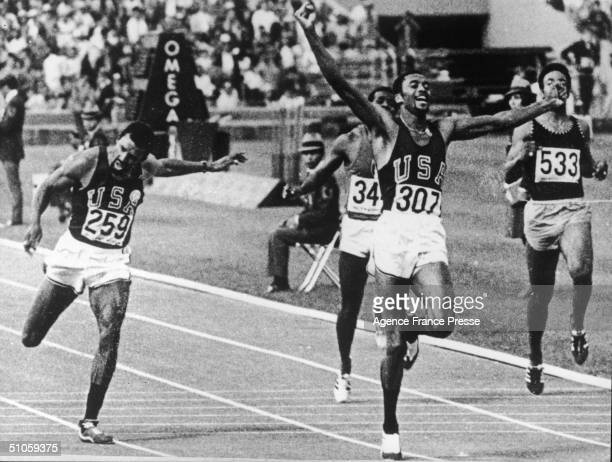 A jubilant American long sprinter Tommie Smith raises his arms as he crosses the finish line to set a new world and Olympic record at the 19th...