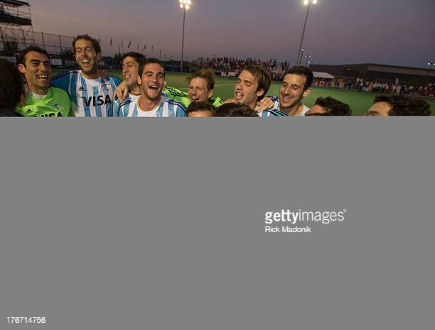 Jubilant Argentina team celebrates after the final horn. Mens Pan American Cup final between Canada and Argentina, in Brampton, August 17, 2013. The...