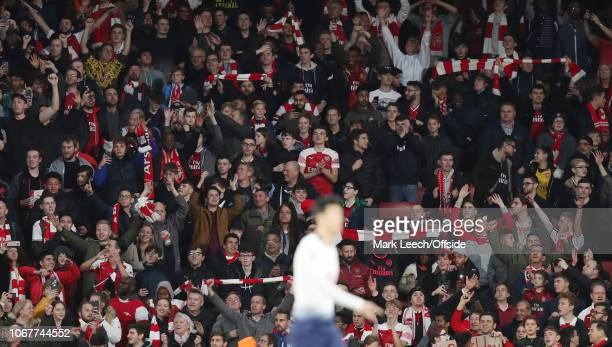 Jubilant Arsenal supporters after the final whistle of the Premier League match between Arsenal FC and Tottenham Hotspur at Emirates Stadium on...