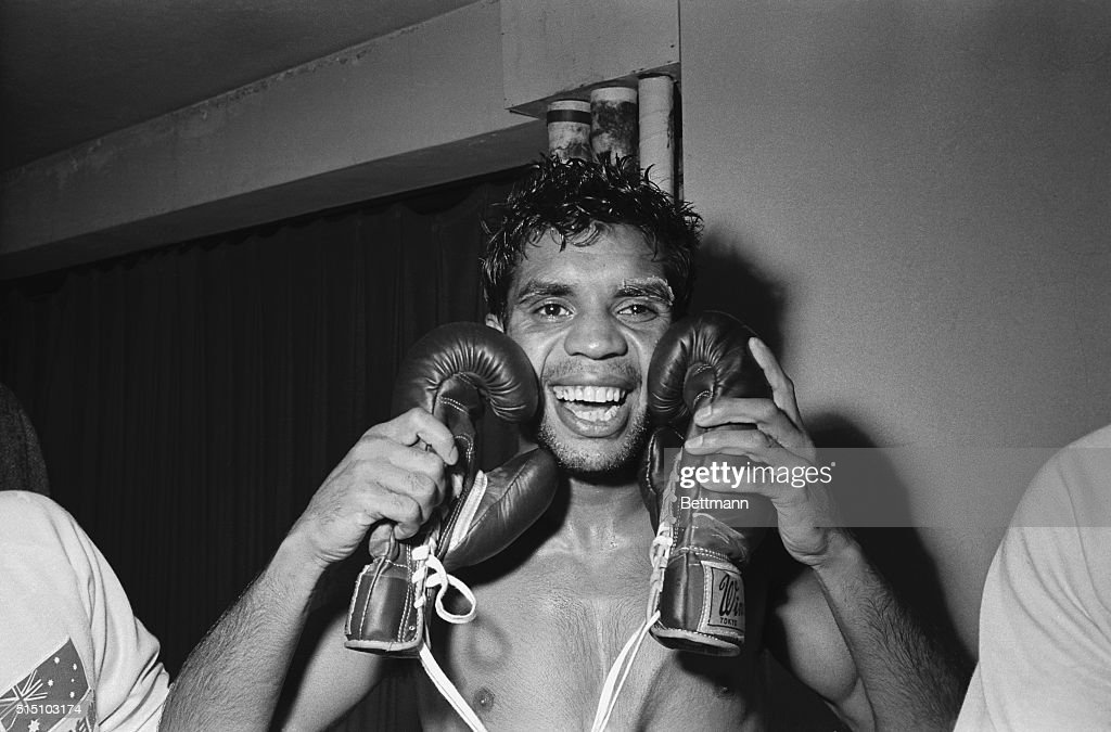 Lionel Rose Embracing his Boxing Gloves : News Photo