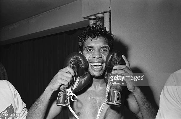 Jubilant Australian Lionel Rose embraces the gloves that won him the world bantamweight title here February 27th as he punched out a unanimous...