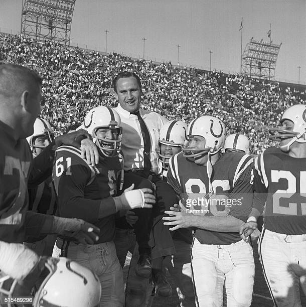 Jubilant Baltimore Colts carry Coach Don Shula here off the field after they beat the Los Angeles Rams 247 to sew up The National Football League's...