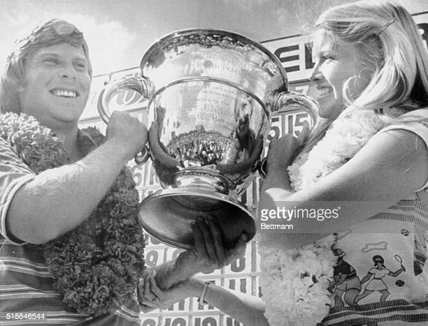 A jubilant Ben Crenshaw and his wife Polly celebrate his Hawaiian Open win Crenshaw fired a final round 66 for a 72 hole total of 270 breaking a...