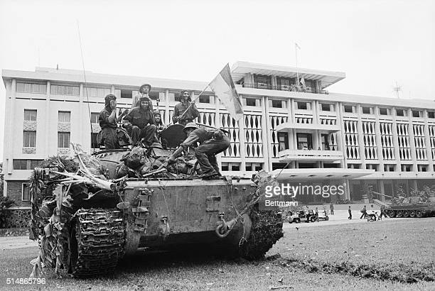 Jubilant Communist soldiers on Russian made T54 tank wave the flag of the provisional revolutionary government after they have taken over the...