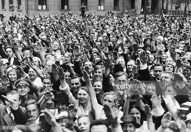A jubilant crowd salutes Nazi Leader Adolf Hitler outside the Reich Chancellery Berlin after a plebiscite which gave Hitler absolute power as German...