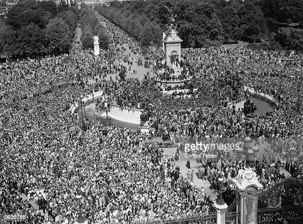 Jubilant crowds gather outside Buckingham Palace hoping to see the King following news of Japan's surrender at the end of World War II