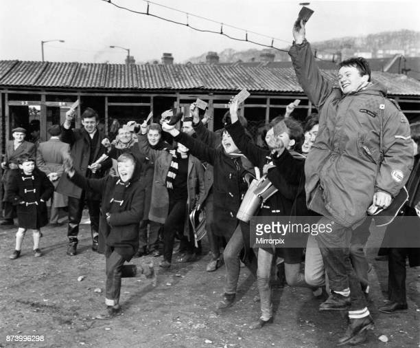 Jubilant Crystal Palace fans proudly hold aloft their tickets after having queued since midnight the night before to purchase them They will be...