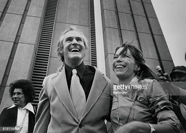 A jubilant Dr Timothy Leary high priest of the 1960's drug culture and his wife Joanna leave the Federal Correctional Center here April 21st He had...