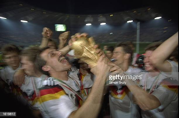 Jubilant German footballers celebrate their victory over Argentina in the 1990 World Cup Final in the Olympic Stadium in Rome Italy Mandatory Credit...