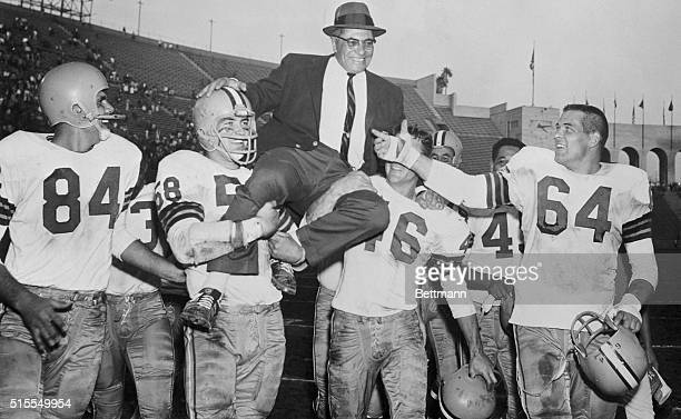 Jubilant Green Bay Packer players give coach Vince Lombardi the traditional victory ride after the Packers defeated the Los Angeles Rams 3521 and...