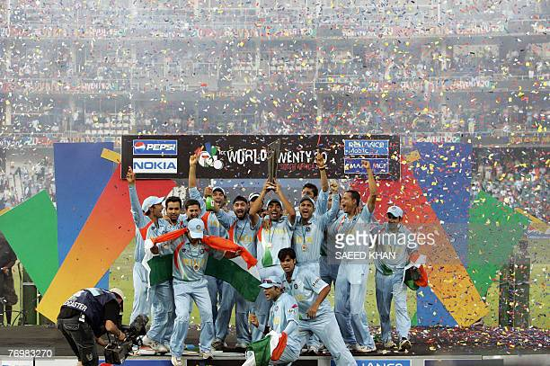 Jubilant Indian cricket team players raise the ICC World Twenty20 trophy after defeating Pakistan in the final at the Wanderers Cricket Stadium in...