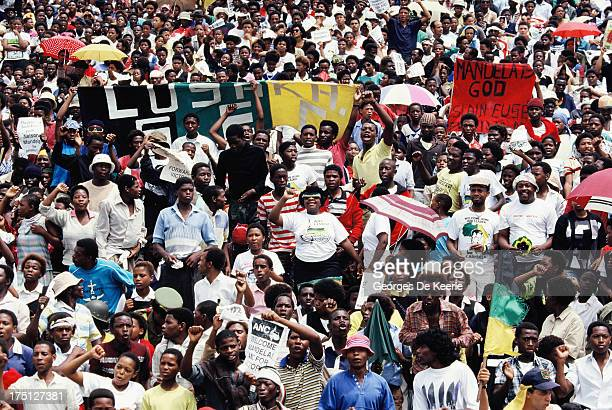 Jubilant inhabitants of Soweto attend a mass African National Congress rally to be addressed by freed anti-apartheid leader and African National...