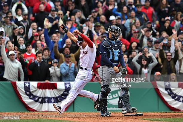 Jubilant Jacoby Ellsbury crosses home plate with the game winning run on a RBI single by Boston Red Sox right fielder Shane Victorino in the bottom...