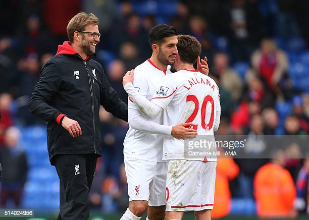 A jubilant Jurgen Klopp manager of Liverpool with Emre Can and Adam Lallana of Liverpool after the Barclays Premier League match between Crystal...